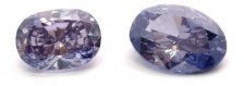 0.18-carat Fancy Dark Violet and a 0.13-carat