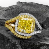A 3.92 carat, fancy yellow, pave cross-over d