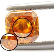 Orange Diamond with a Magnified Inclusion