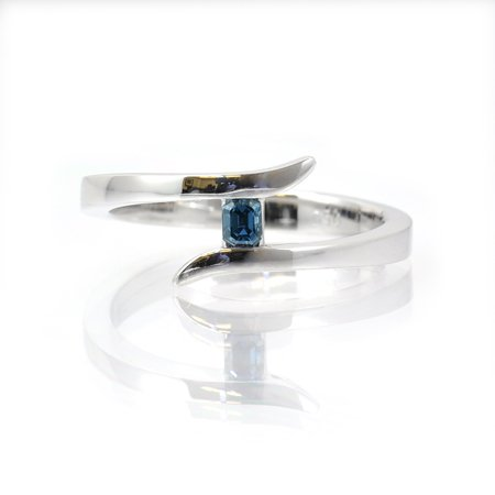 0.12 carat Fancy Deep Blue emerald cut diamond ring