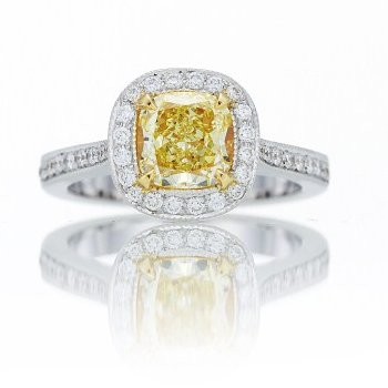 A 1.08 carat Fancy Yellow radiant halo semi-eternity diamond ring