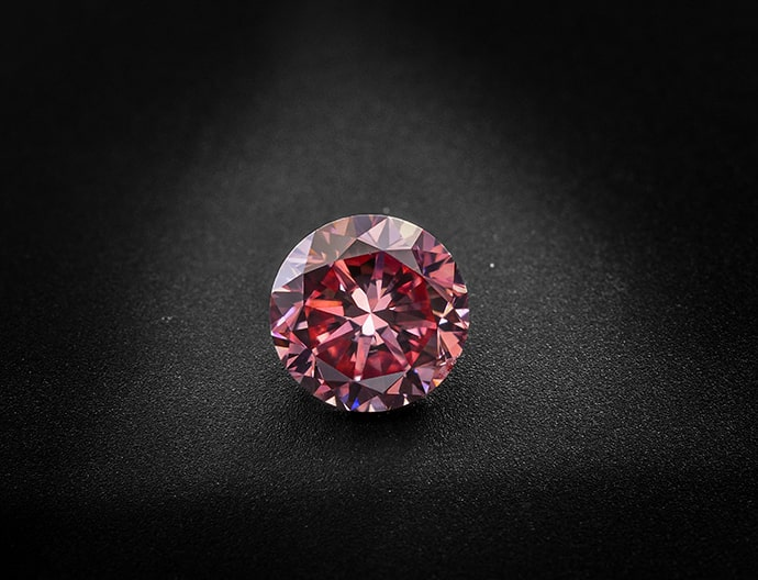 A 0.70 carat, Fancy Vivid Pink Diamond, Round Shape, SI1 Clarity, GIA