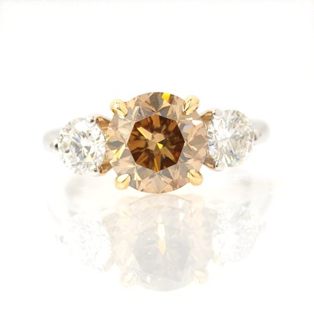 2.07 Carat, Fancy Yellowish Brown three stone diamond ring, Round, VS2