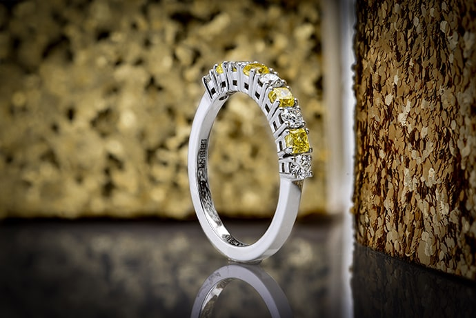 Yellow and white diamond wedding band