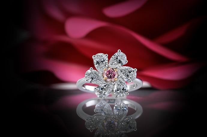 A 2.86 carat (TW) fancy intense purplish pink diamond ring in a floral design