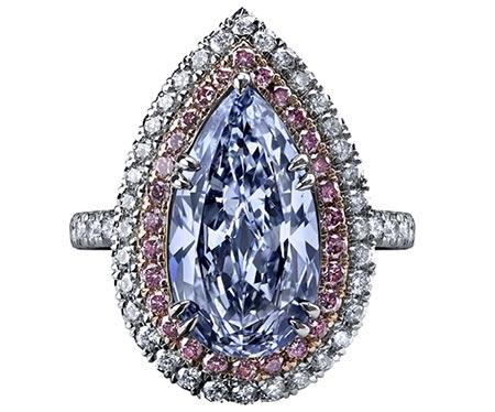 A 4.47 carat, fancy-blue, pear-shaped diamond ring