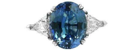 5.68 Carat, Oval Tanzanite and Triangle Diamond Ring