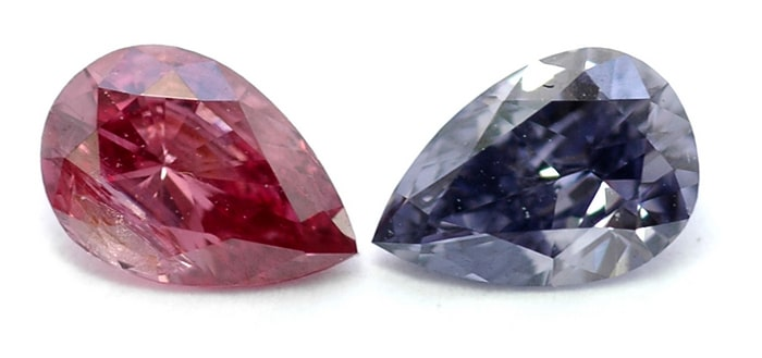 A Fancy Deep Pink pear shaped diamond and a Fancy Violet pear shaped diamond