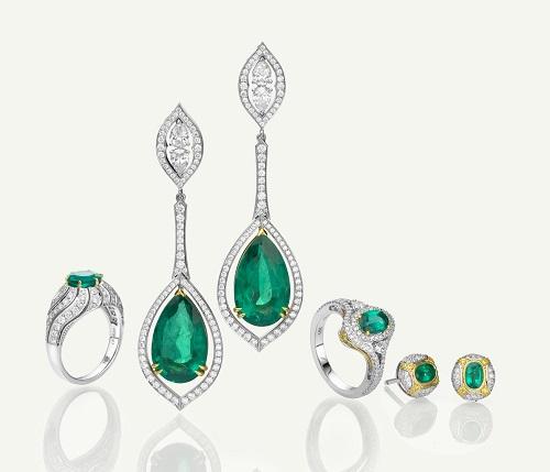 Assorted emerald and diamond jewelry