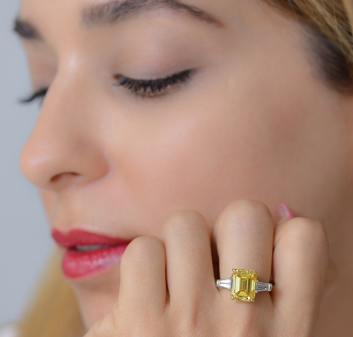 Batel with a 5.01 carat Fancy Vivid Zimmy Yellow Diamond Ring