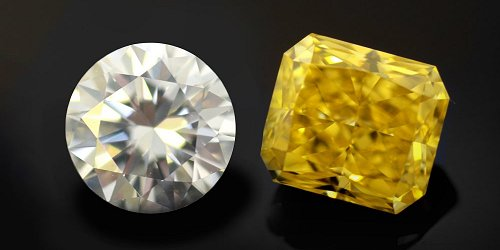 A natural yellow diamond next to a colorless diamond