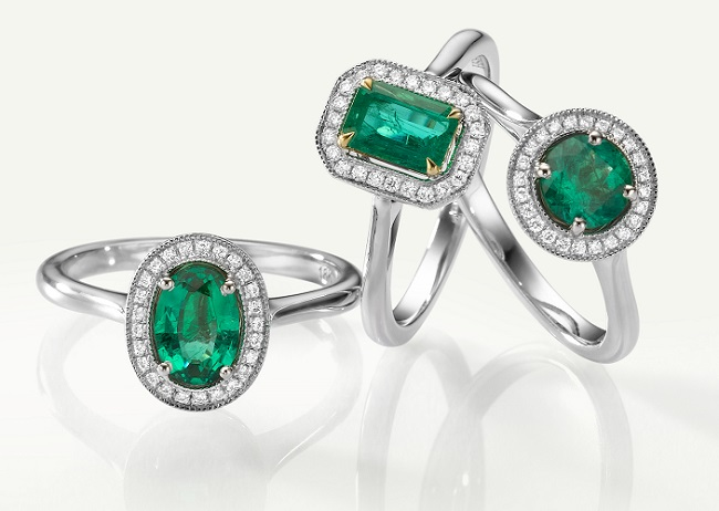 A pile of LEIBISH Emerald and Diamond halo rings