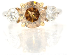 Round Fancy Yellowish Brown and Colorless Three Stone Ring