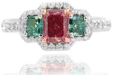 0.53ct Radiant cut Argyle Fancy Red VS1 diamond and two Fancy Deep Blue-Green diamonds, a 0.16ct and a 0.18ct, and a 0.38 ct tw Halo and set in Platinum and Rose gold