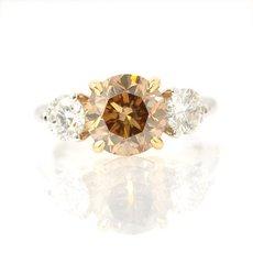 2.07 Carat, Fancy Yellowish Brown three stone diamond ring, Round, VS2