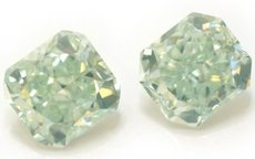 A pair of 3.42 total carat weight, Fancy Green Radiant Diamonds