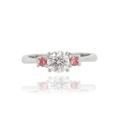 Pink and white round shape classic 3 stone engagement ring