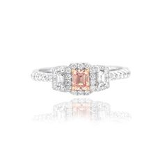 Pink emerald shape Halo and Trapezoids accent engagement ring