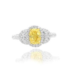 Yellow_oval-_shape_set_in_a_Halo_and_half_moon_accent_engagement_ring