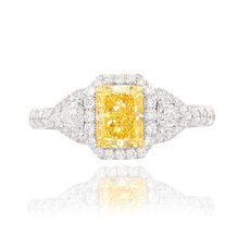 Yellow_radiant _shape_set_in_a_Halo_and_Triangle_accent_engagement_ring