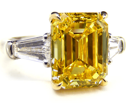 5.91 Fancy Intense Yellow Emerald Cut Diamond Ring with 0.90 ct Baguette Side Stones