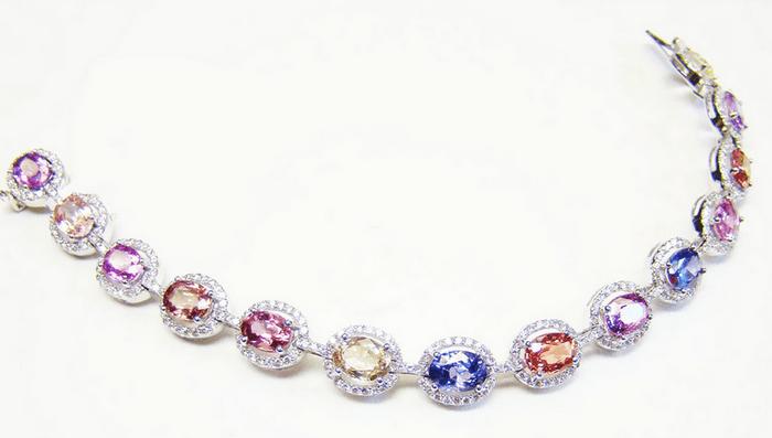 Multicolor Sapphire bracelet with diamond halos