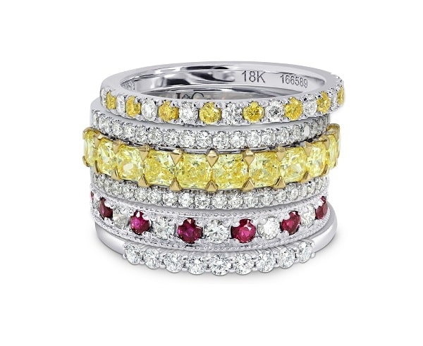A Stack Of Diamond Yellow And Gemstone Wedding Bands