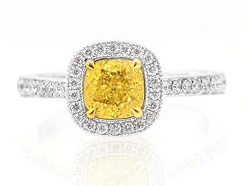a Leibish & Co. Vintage style Fancy Intense Yellow cushion diamond halo ring
